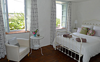 A bedroom at Le Petit Potager